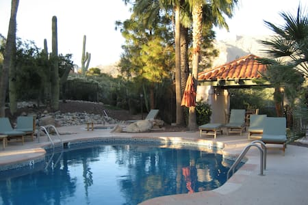 """Privately owned beautiful ground floor 2 bed, 2 bath condo in the Catalina Foothills.  Newly furnished w/stylish decor mixing modern w/antiques.  High linens, appliances & 32"""" & 20"""" flatscreed TV's.  Cable TV with 50+ stations & WI-FI.  Pool & Spa."""