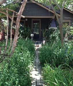 My 1920s bungalow includes two guest bedrooms with queen sized beds, down comforters, feather/down pillows, silk curtains and private bathroom.  The guest area also includes a garden porch, private entrance, living room and handmade maple work table.
