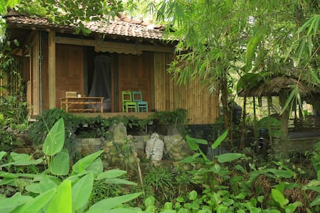 This small, charming historical wooden house is situated with a beautiful view over rice fields.  Located on the edge of a small village, it offers a perfect mix of living in tropical nature with fast access to the city center of Yogyakarta.
