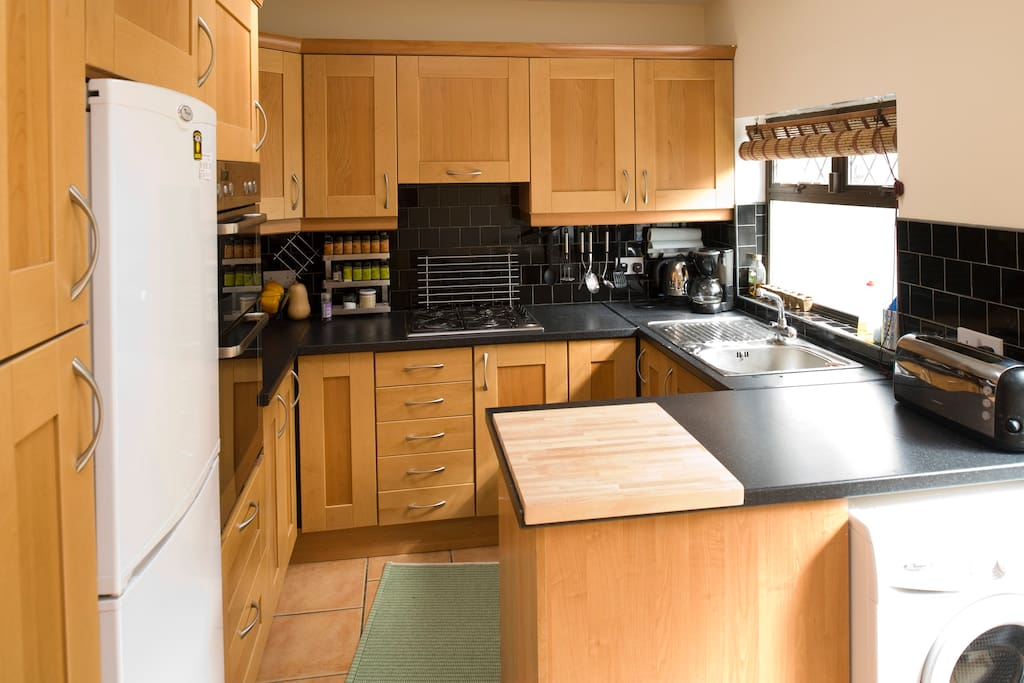Kitchen- lots of cupboard space. All the necessary tools to cook a great meal. We even have a BBQ outside that you can use!