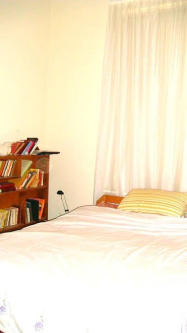 Your bed and bookcase with reading light