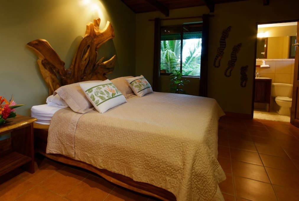 Master bedroom has a king size solid teak bed, very cozy with it's own bathroom