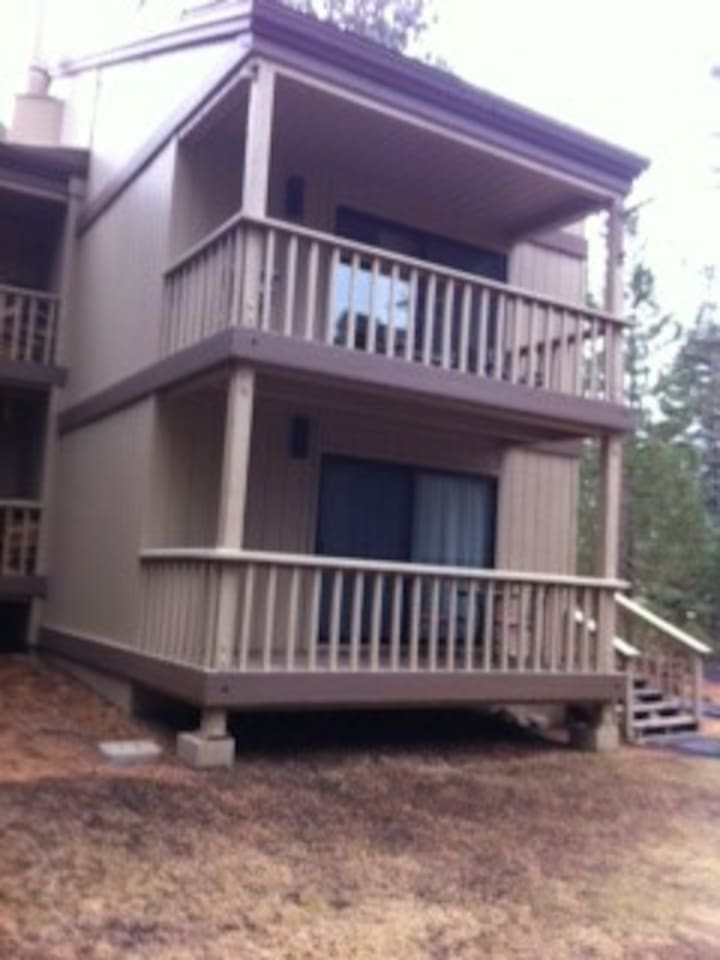 Front of condo with 2 decks. Top deck off living area. Bottom deck off master bedroom.
