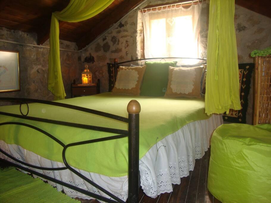 Bedroom in mezzanine.