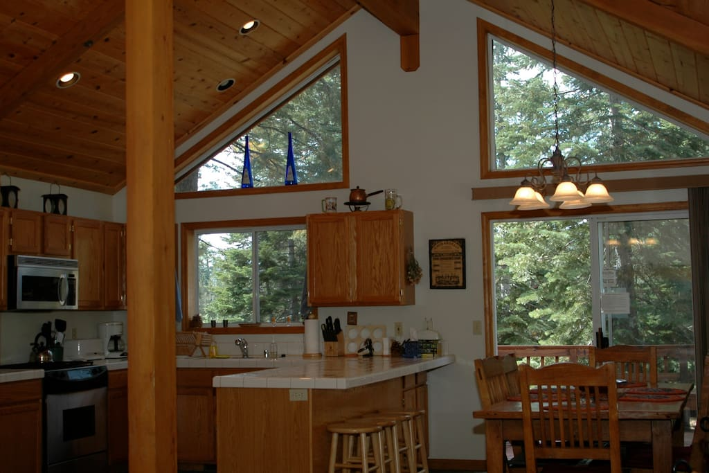 Open, sunny and fully stocked kitchen and dinning area