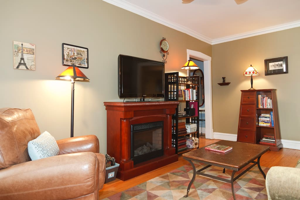 "Living room with a cozy electric fireplace and 42"" Samsung LCD TV w/cable & DVD player."