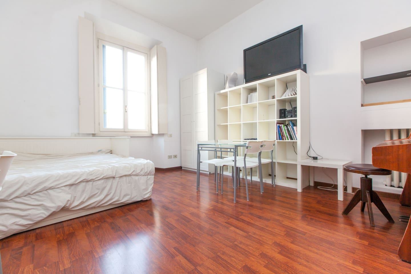 This is the studio. In one only room there is a lot for enjoying your stay in Milan, including a piano