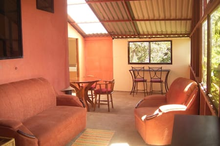 A small one bedroom apartment attached to our home. The bedroom has a double bed and we have three blow-up mattresses that can be put in the bedroom or living area. Located in San Isidro de Heredia, just a 20 minute drive from San Jose or Heredia.