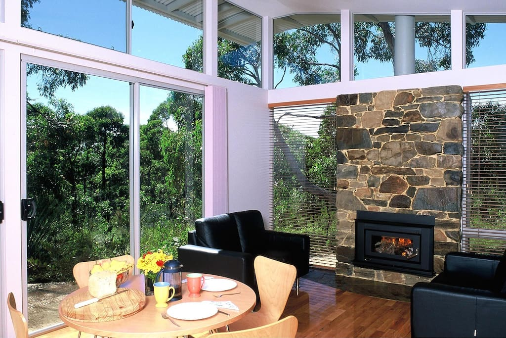 Floor to ceiling windows provide panoramic views of the peacebul bush.