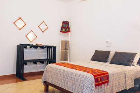 Comfortable room for two people with one double bed and private bathroom! Quiet, good ambiance in the heart of Tulum town. Minutes away from the bars and restaurants area.