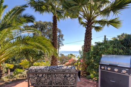 This one bedroom apartment features the entire lower level of a two story New England style house which overlooks the Pacific and Channel Islands. It's just a short walk down the hill to Overlook Park with beach access and to the town of Summerland.