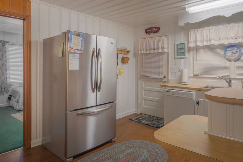 Brand new refrigerator with ice maker.