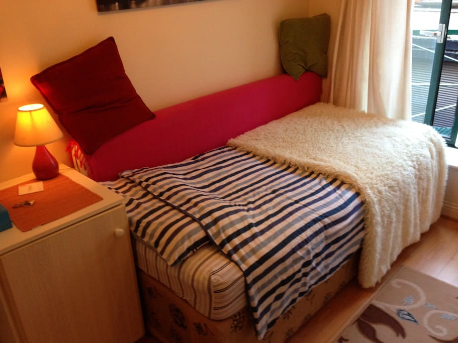 Your room with a single bed, 2 wardrobe, 1nightstand with drawers, shelves and a large mirror.