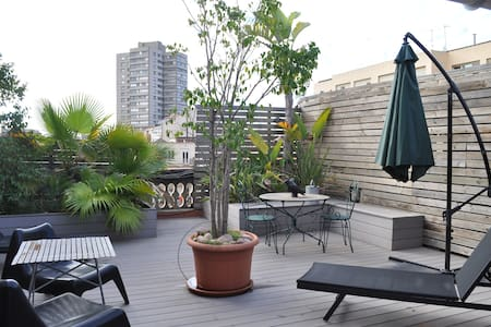 Spacious 80m2 loft apartment with a 15m2 wide terrace. Very sunny and quiet.   Excellent option to spend relaxing days in Barcelona.  Second terrace for the second room with view to the other side.