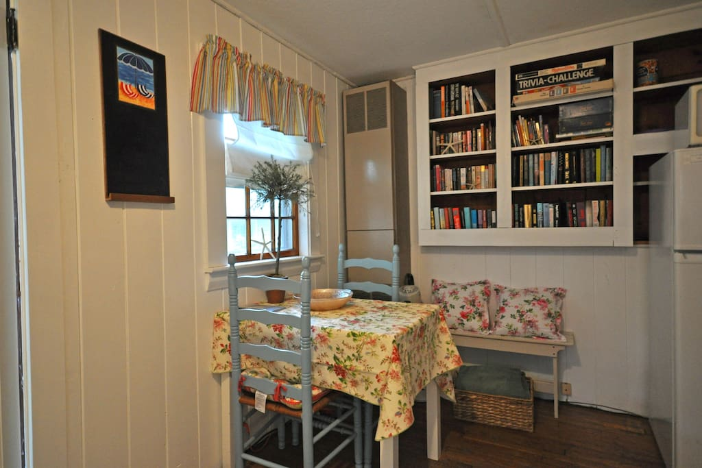Dining area. Small library, if you don't finish a book-take it with you! Games for a rainy day.
