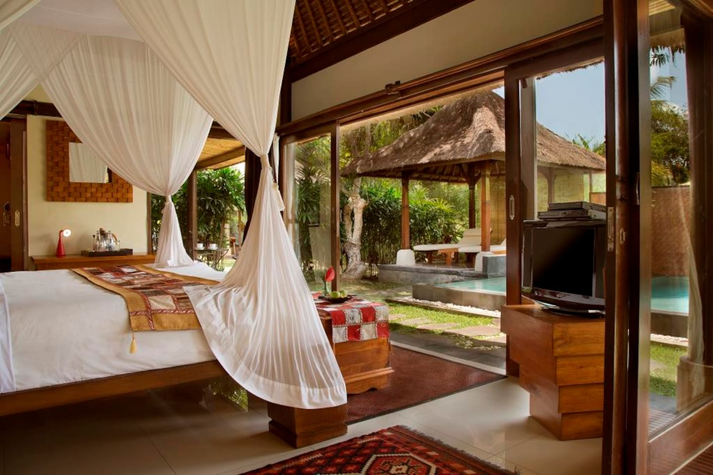 Villa Shanti Om is a luxury villa with a full bath and its own private garden, pool and two patios