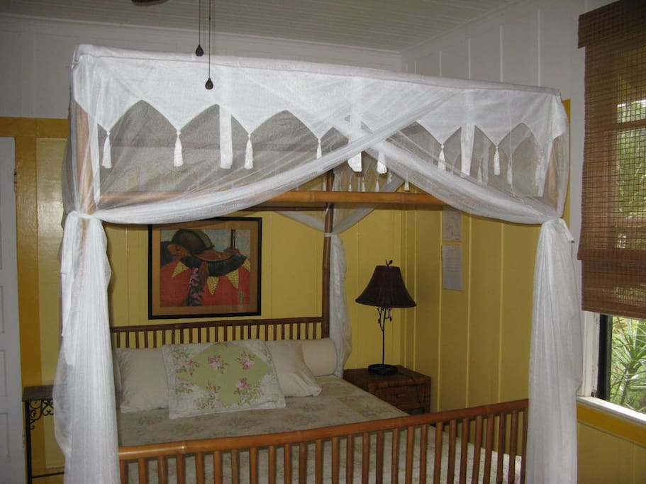 Four poster Bamboo queen sized bed with mosquito netting.