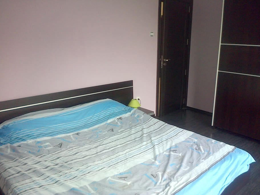 The first bedroom with king size bed and large wardrobe