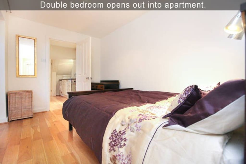 Double bedroom opens out into apartment.