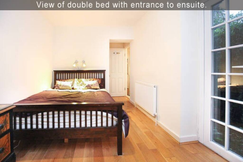 View of double bed with entrance to ensuite.