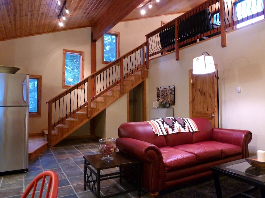 Spacious loft with comfy red leather sofa (queen sleeper pullout)