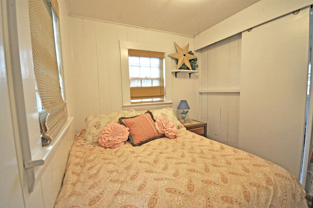 Separate bedroom with full size bed & window A/C unit.