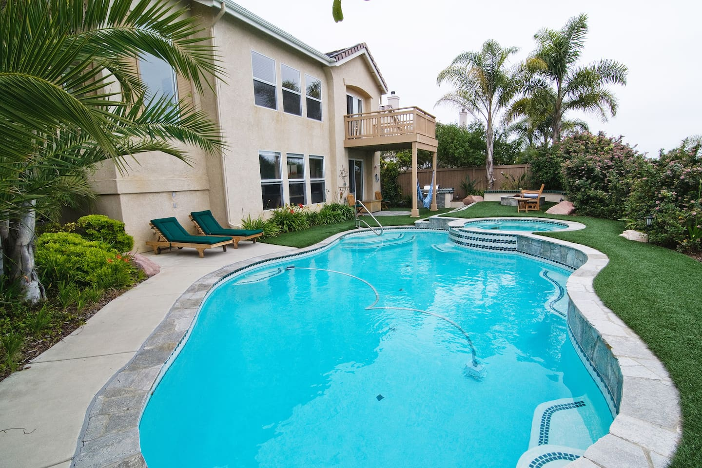 Pacific oceanview backyard with pool, jacuzzi, hammock, fire-pit, gas grill