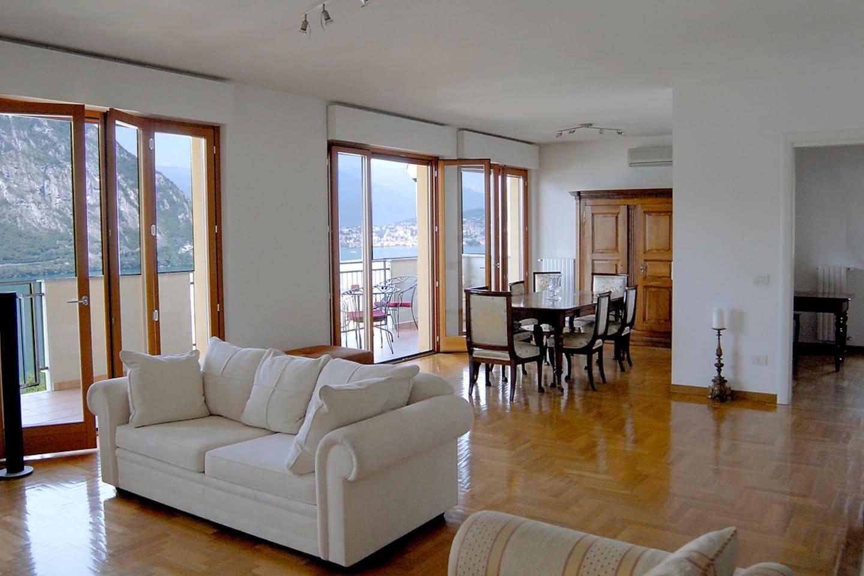 Living room with panaoramic view on lake Lugano, Terrace 45 m2.