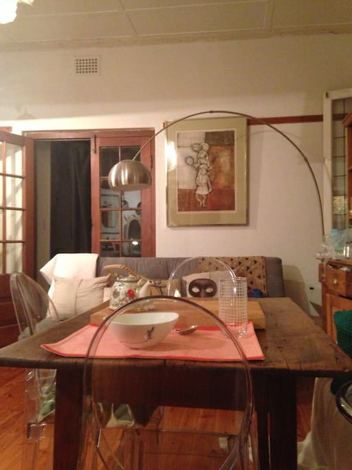 lounge & eating room with sleeper couch  & arc lamp