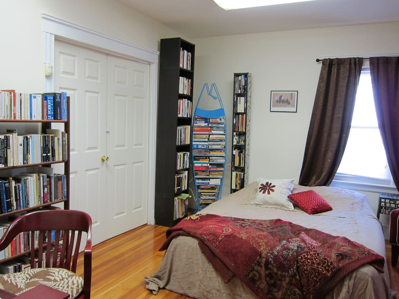 Spacious, sunny guest room. Also: some books.
