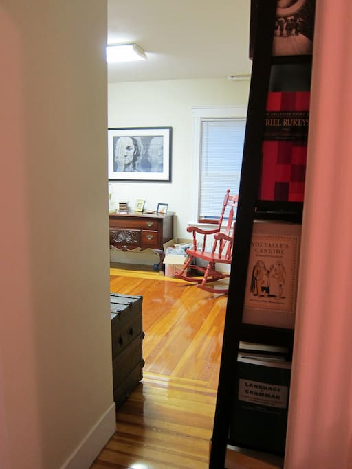 In which Airnbn refuses to accommodate vertically oriented photographs. Living room. Voltaire. Art.