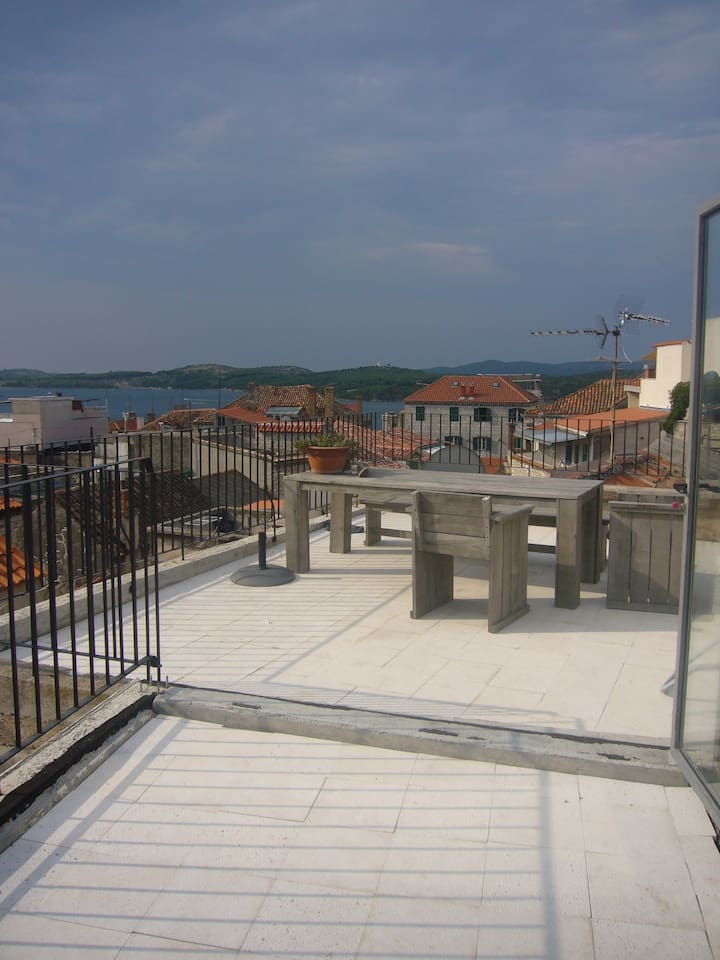Spacious roof top terrace overlooking the old town, viewing the bay of Sibenik and 2 fortresses.