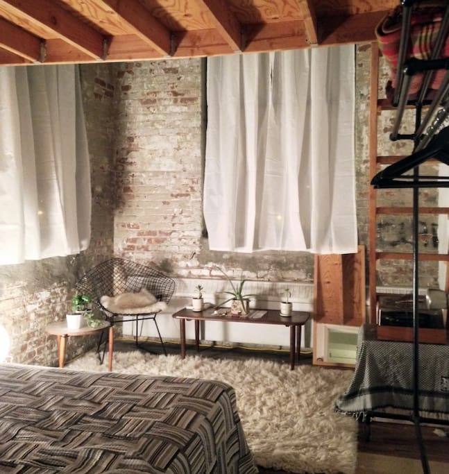 Flocati Rug, Comfy Bed, Brick Walls, and Three Awesome Windows!