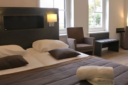 Luxe kamer met bubbelbad - Bed & Breakfast