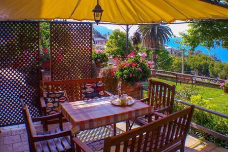 La tua casa con giardino sul mare - Apartment