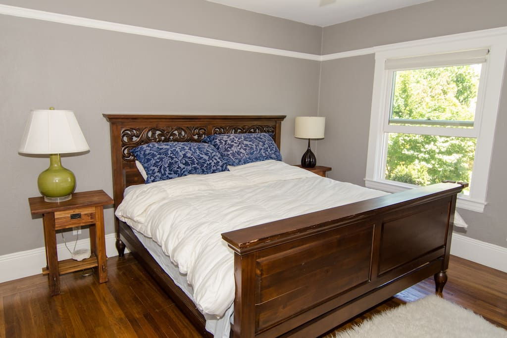 Eastern King sized bed and fluffy sheets and down comforter.