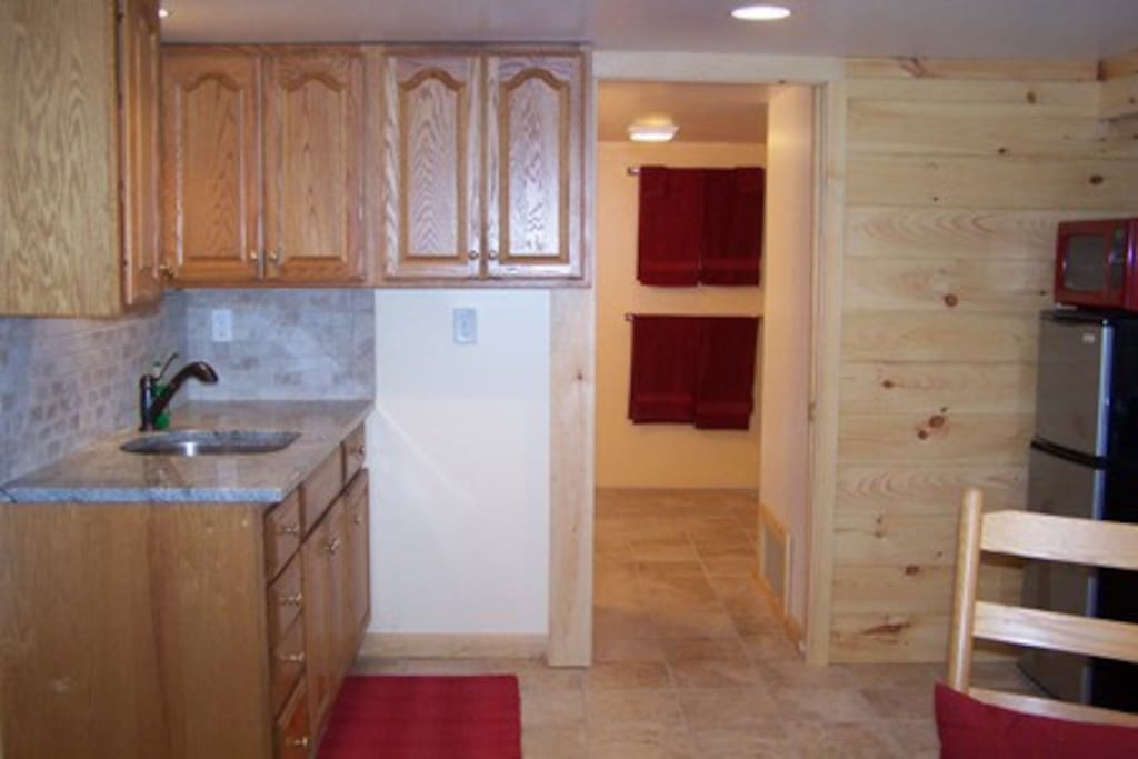 Kitchenette with granite countertops and KraftMaid oak cabinets