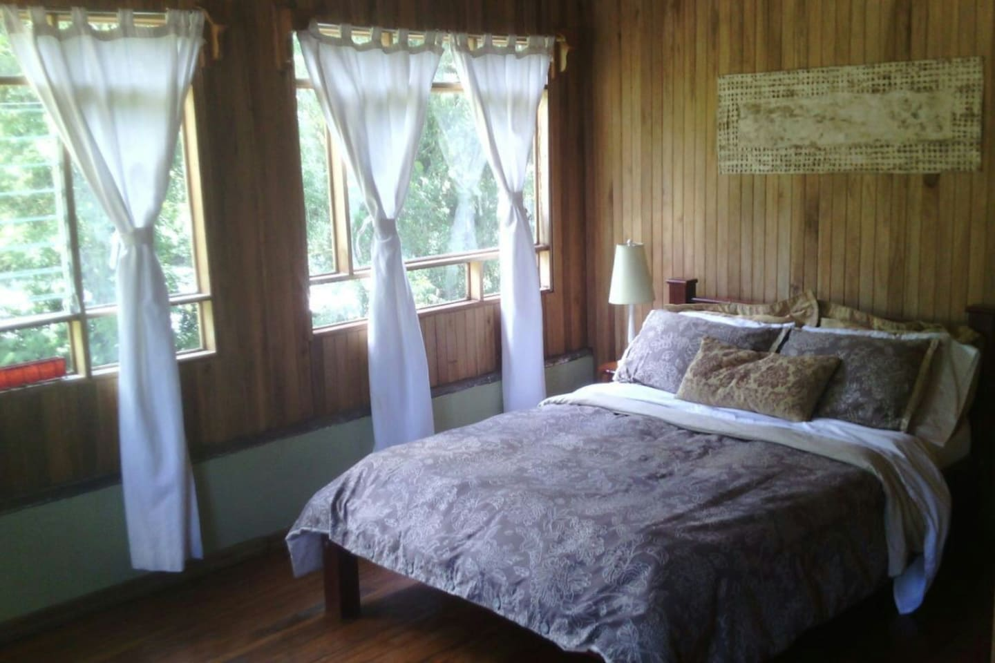 Guest bedroom with rain forest and river views