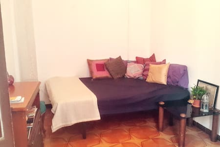 Big light private room with private balcony in the middle of El Borne.  The room is spacious and perfect for 2 people. It has a double bed 135x190. Two tables and a sofa to relax on. The flat is small and charming, authentic El Borne style.