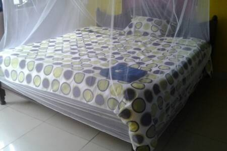 Private room with king size bed - Kisumu