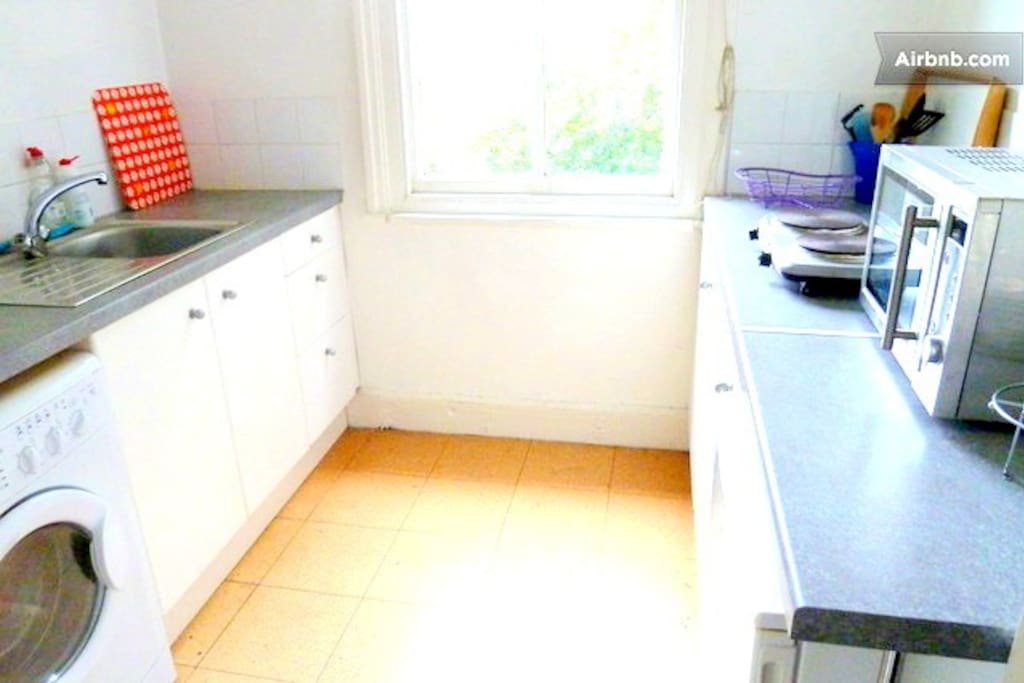 Private kitchen with washing machine, microwave, electric hob (now induction hob). Also toaster and kettle.