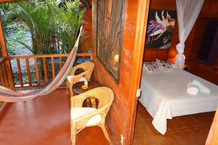 This casita is approximately 36 square meters.  It has its own kitchen and dining room area as well as a covered outdoor living room.  Breakfast is not included in the price.  Casitas Las Flores is a small bungalow resort nestled in the jungle.