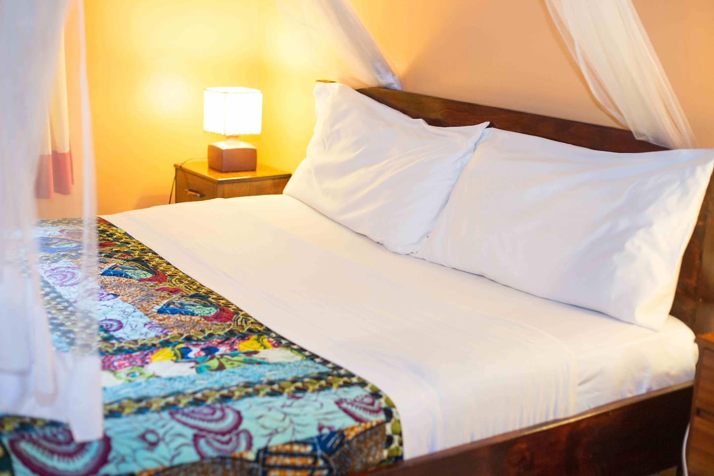 Izuba's colorful local bedspreads made by Rwandan women's cooperative TUBAHUMURIZE