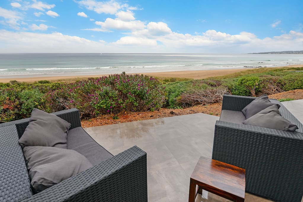 Beach and coast views from the patio. Enjoy a drink and watch forwhales and dolphins