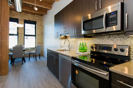 Fully furnished condo with exposed original brick walls, century-old timber beams, with interior modern finishes located off Waterfront in the heart of the Exchange. Located near the Forks. Abundant parking available and public transportation nearby