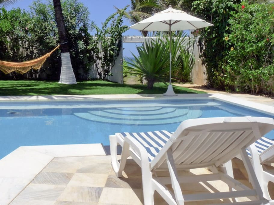 relax in one of the easy chairs by the pool or in the hammock