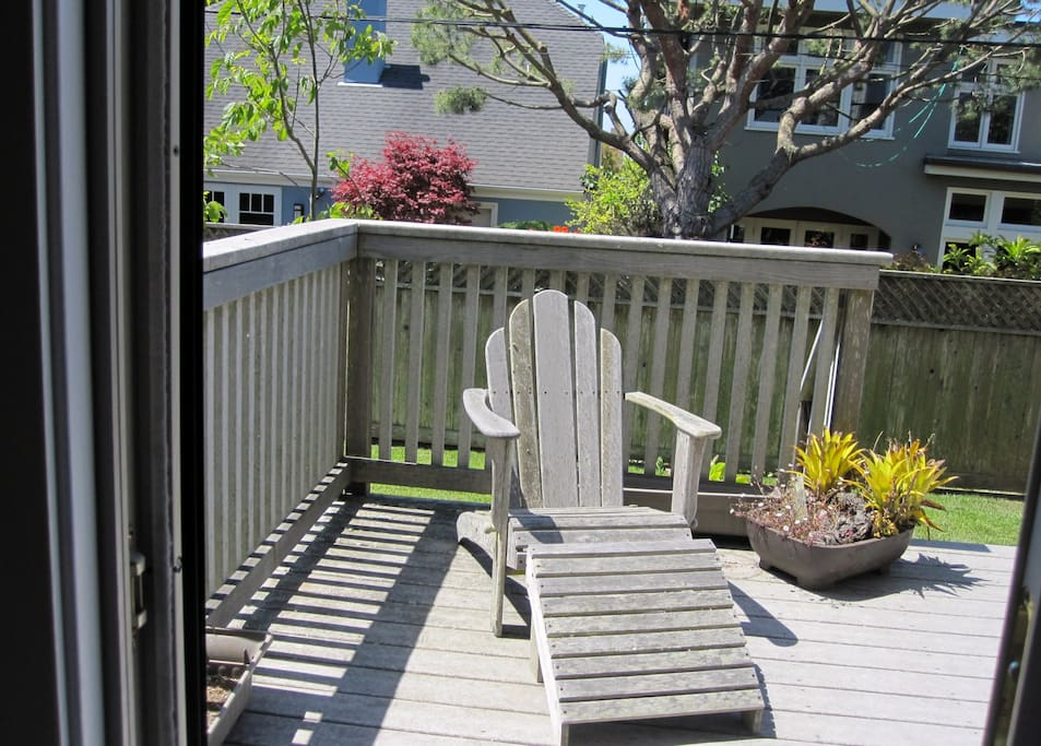 Your room opens onto a deck with a view of the garden