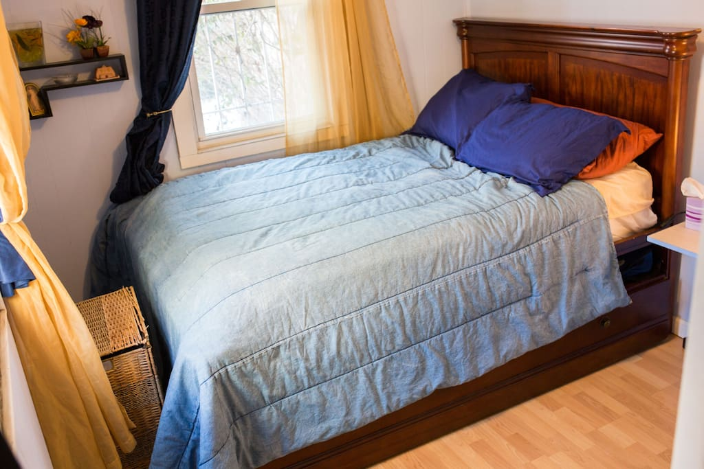 2nd queen sized bed in smaller room in the back of the house.