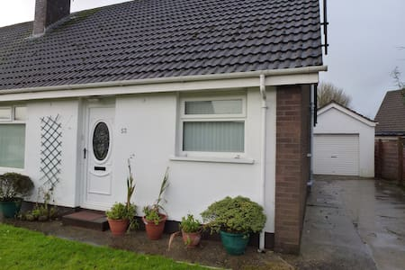 Two Rooms with single beds, extra mattress can be put in bigger room  study table, chair, wardrobe drawers, Fast speed WiFi, Bathroom-toilet-Shower, sitting area in back room and garden,  2 cars parking space in Driveway, Kitchen & washing facility.
