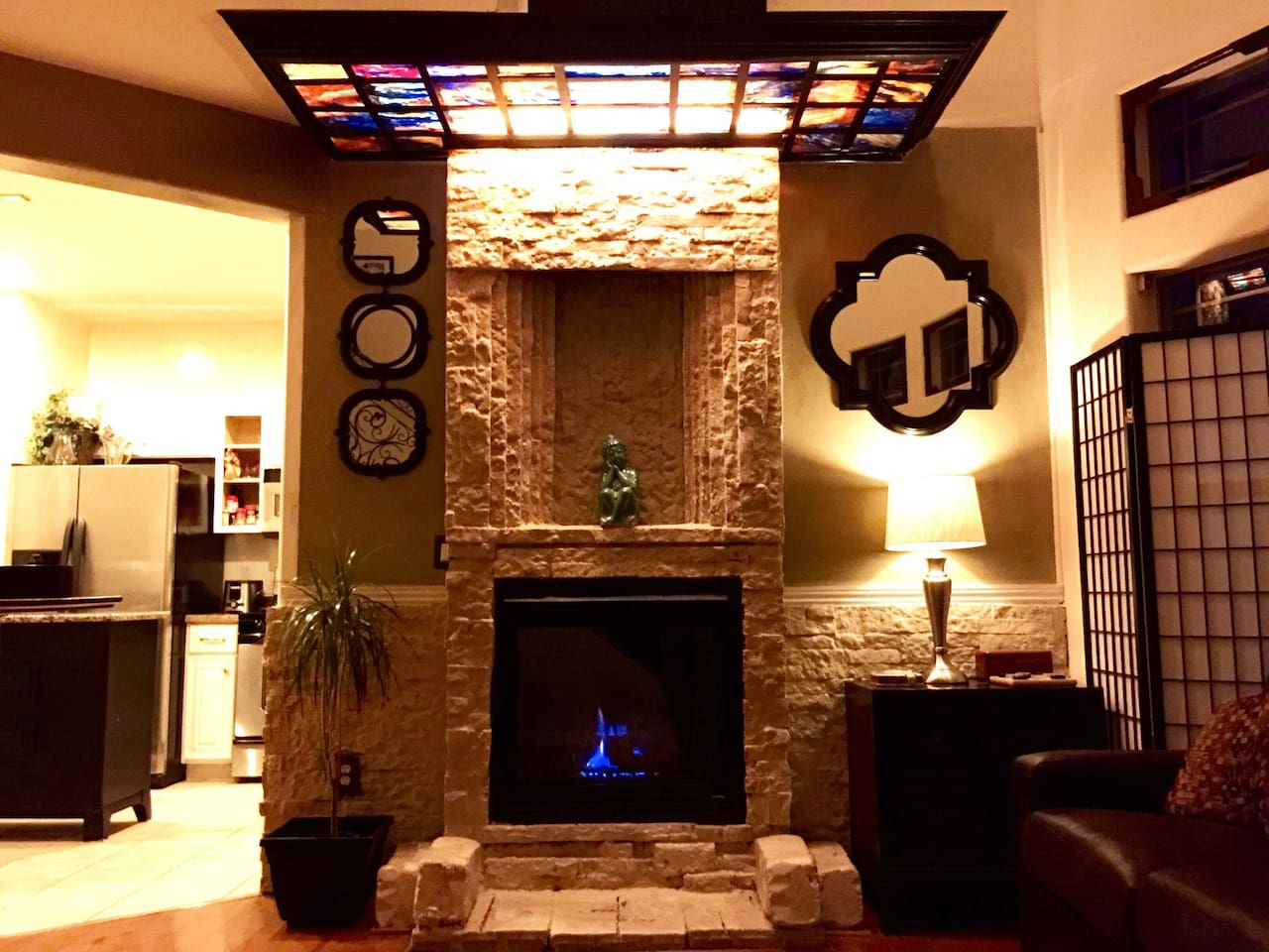 Our gorgeous custom made stone fireplace is the centerpiece of the living room.